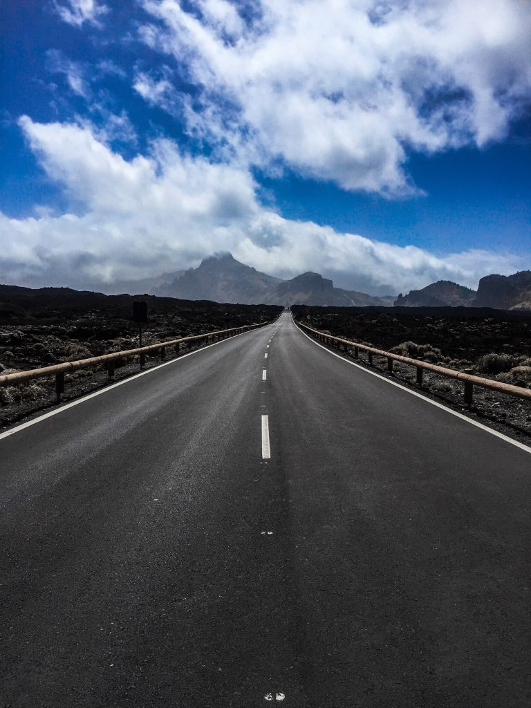 Things to know about Tenerife - roads stretching into the distance with volcanic mountains in the distance.