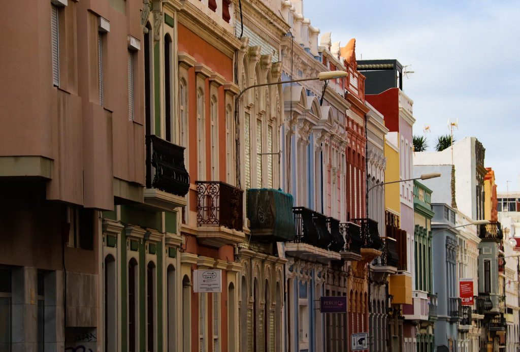 Coloured buildings with iron, railed balconies in Las Palmas.