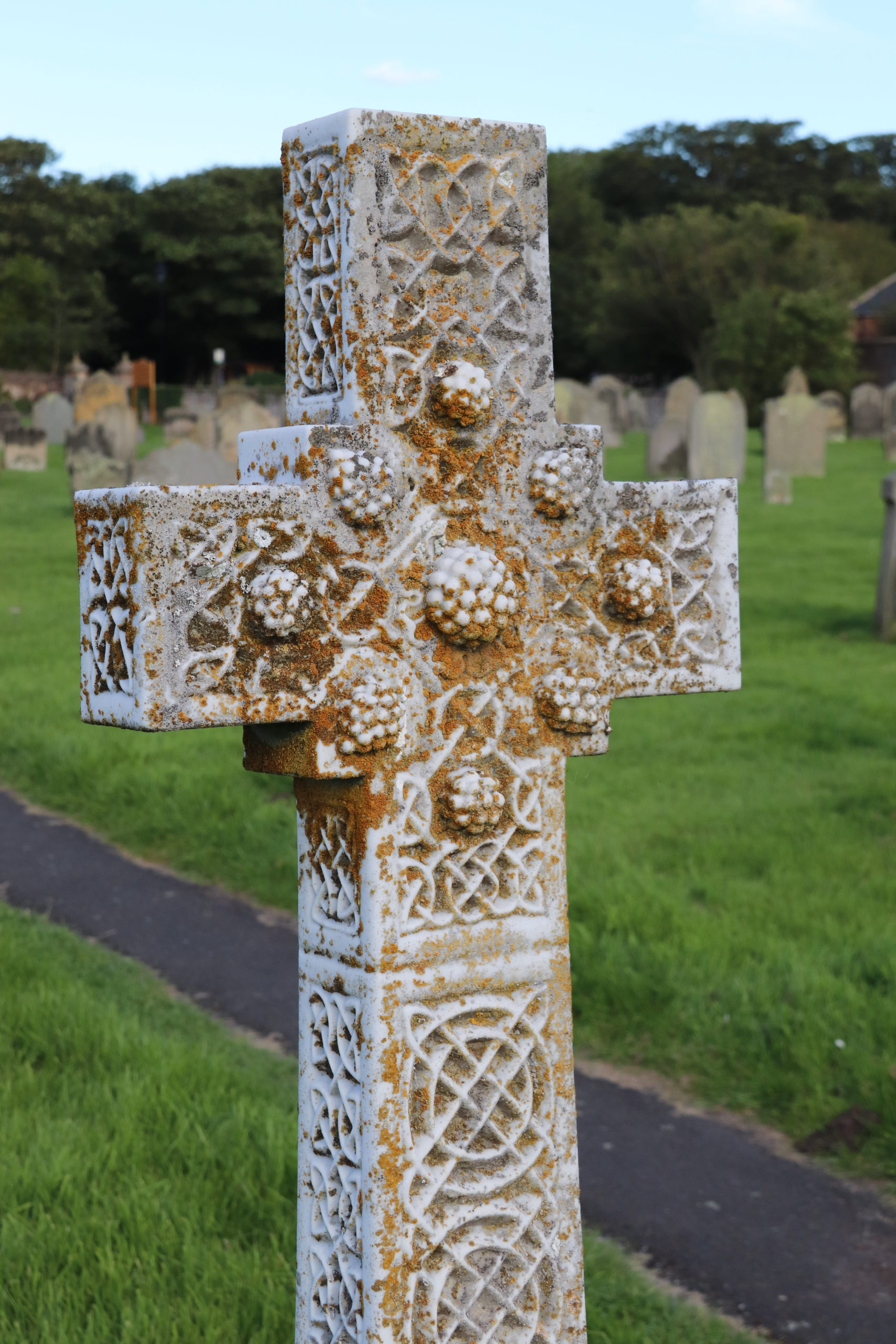 A celtic cross styled tomb stone in St Aidan's church yard.