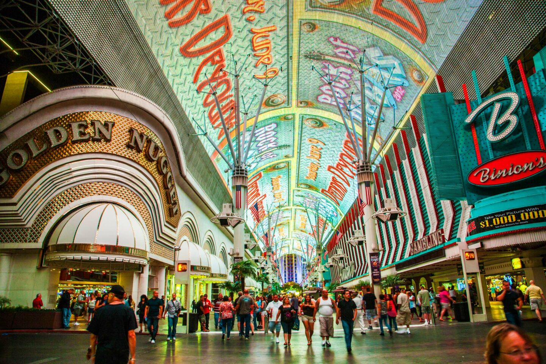 Pedestrians walking beneath the Viva Vision screen along Fremont Sreet, one of the oldest streets in Las Vegas.