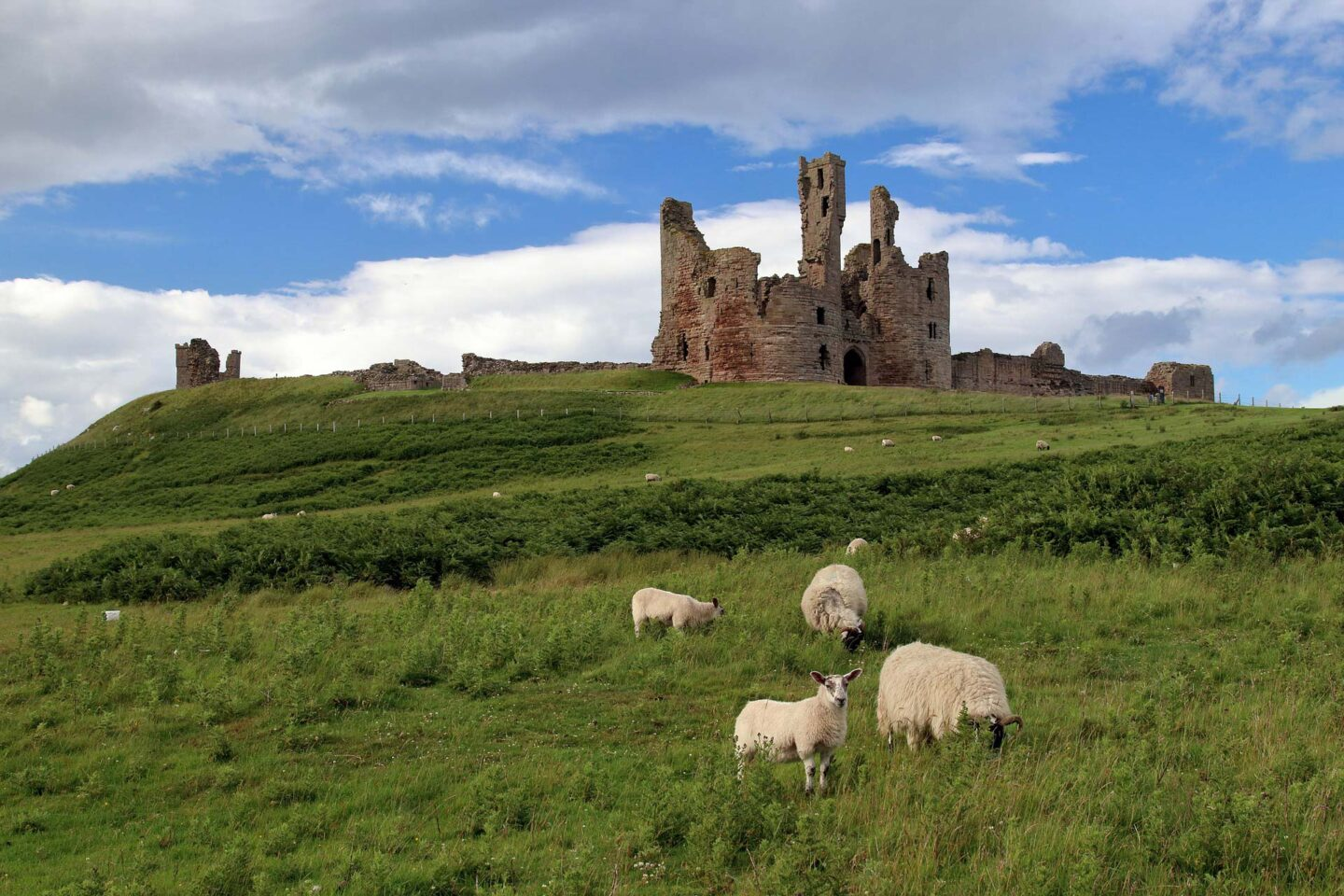 Dunstanburgh Castle, close to the village of Craster on the Northumberland coast