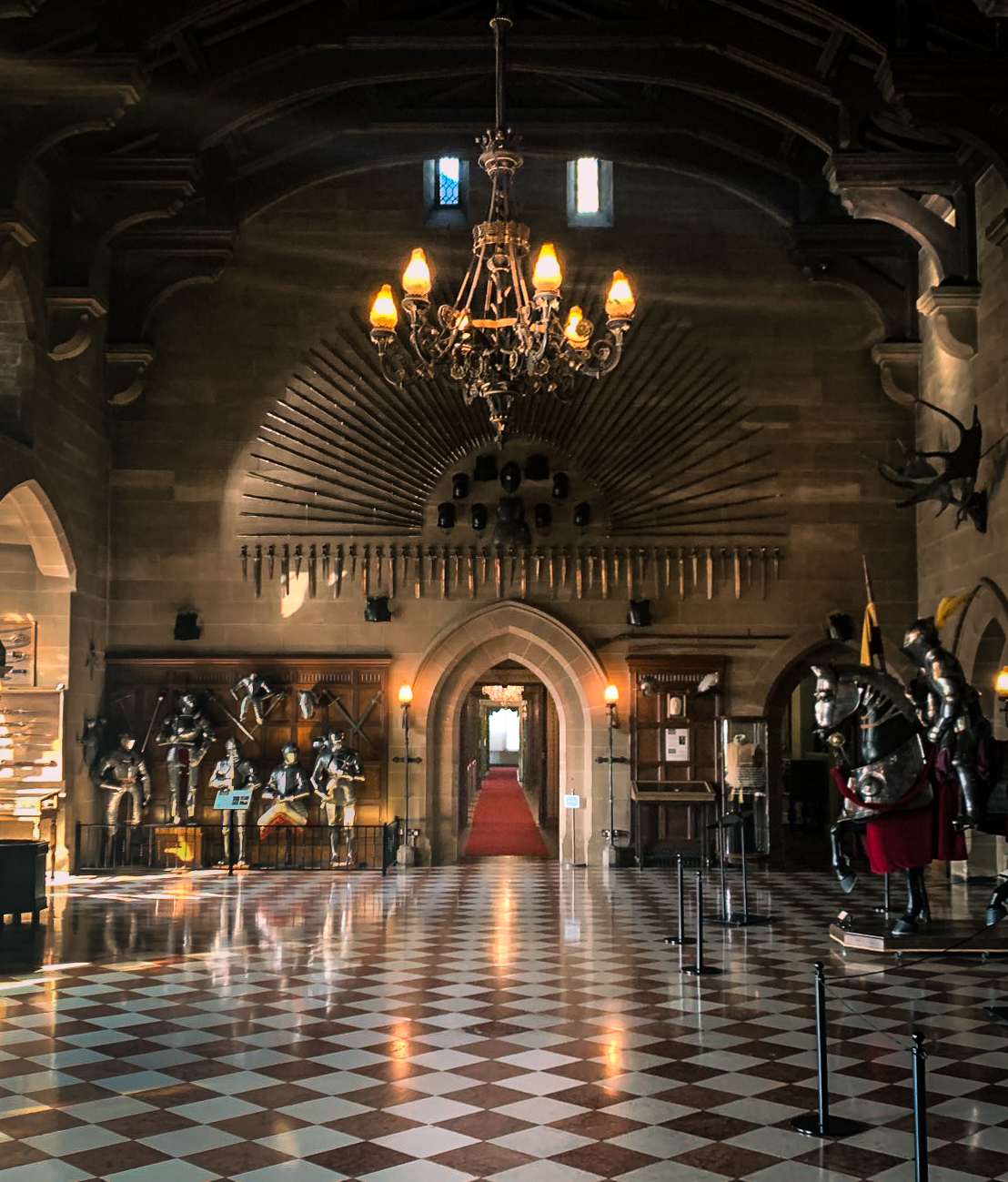 Inside the great hall. It's filled with suits of armour and decorative weaponry. There's a door leading to the state rooms from the centre of the main room.